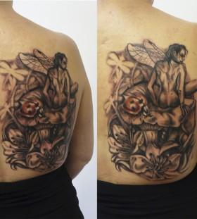 Cool fairy on mushroom back tattoo