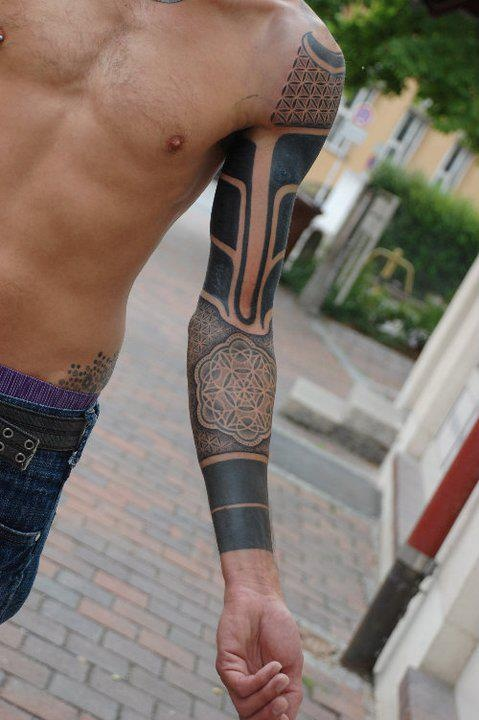 Cool full arm tattoo by Gerhard Wiesbeck
