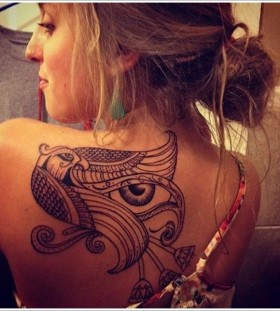 Cool girl's egyptian eye tattoo
