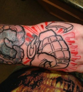 Cool grenade hand tattoo