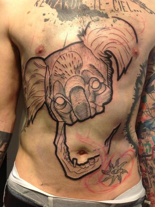 Cool koala's head chest tattoo