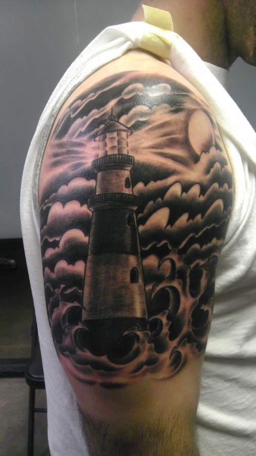 Cool lighthouse arm tattoo