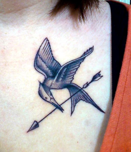 Cool mockingjay chest tattoo