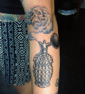 Cool perfume bottle and skull tattoo