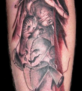 Cool puppet master leg tattoo