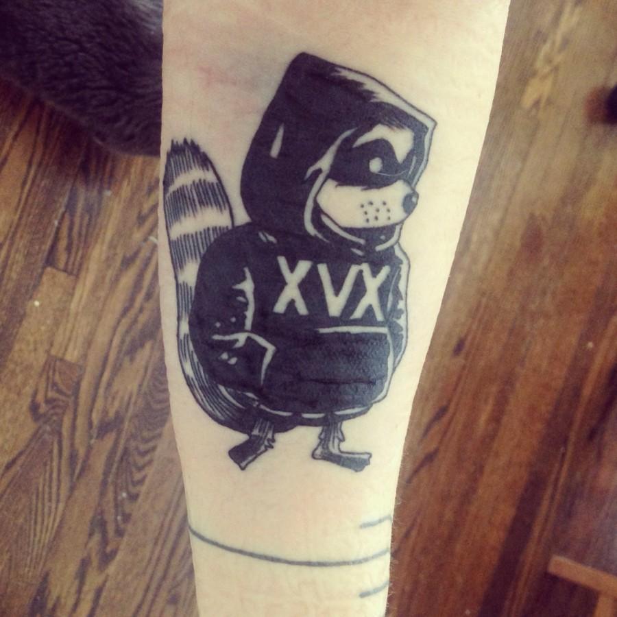 Cool raccoon arm tattoo