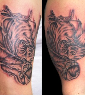 Cool rhino arm tattoo
