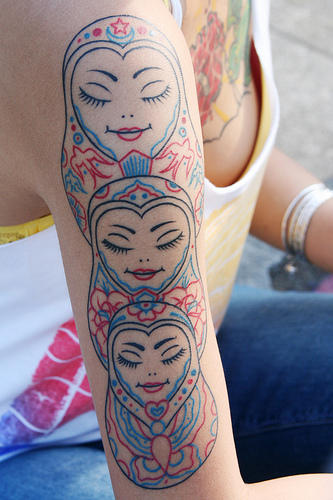 Cool three matryoshkas arm tattoo
