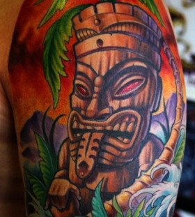 Cool tiki arm tattoo