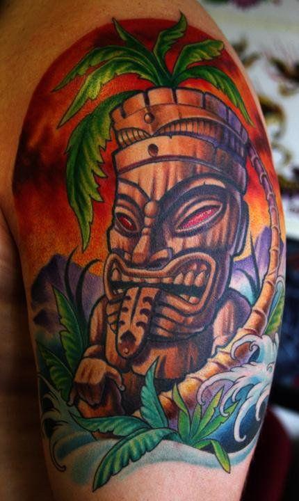 Cool tiki arm tattoo