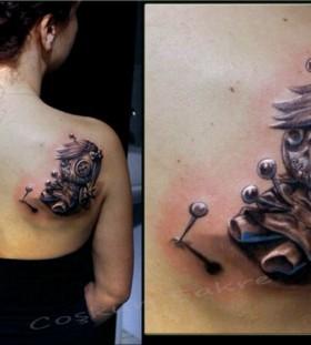Cool voodoo doll back tattoo