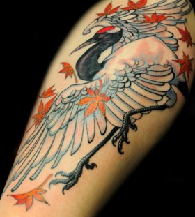 Crane and leaves tattoo