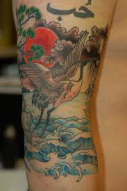 Crane and water tattoo