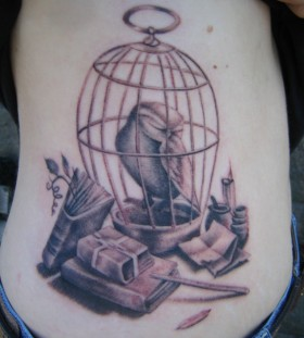 Creative birdcage tattoo design