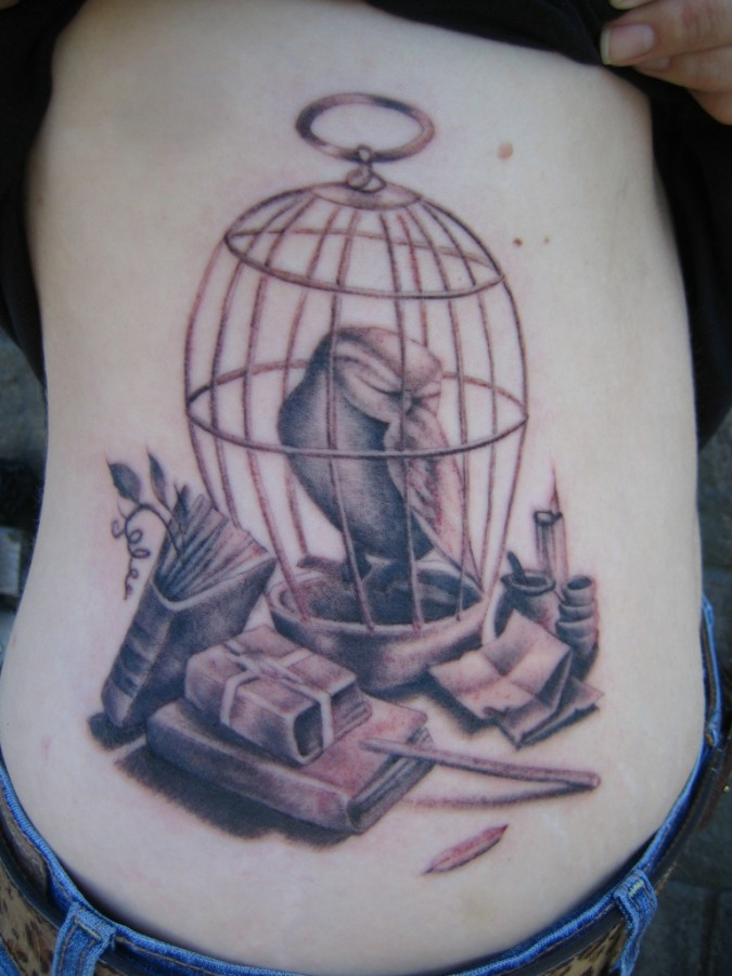 Creative birdcage tattoo design