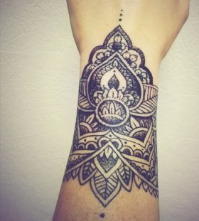 Creative black wrist tattoo