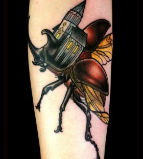 Creative flying bug tattoo