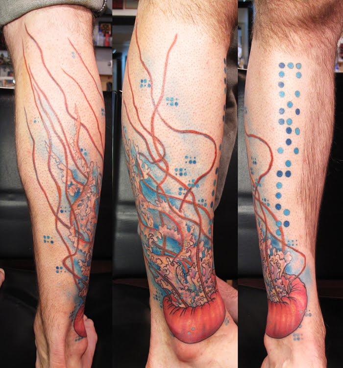 Creative jellyfish arm tattoo