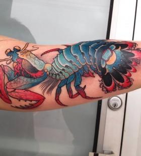 Creative lobster arm tattoo
