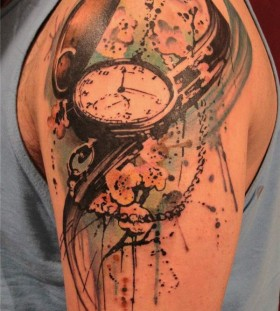 Creative pocket watch tattoo