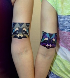 Creative raccoon arm tattoos