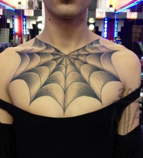 Creative spider web chest tattoo