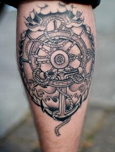 Creative wheel and anchor tattoo