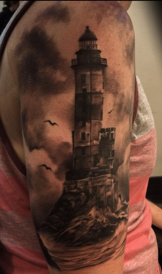 Creepy lighthouse arm tattoo