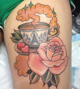 Cup and rose tattoo by Clare Hampshire