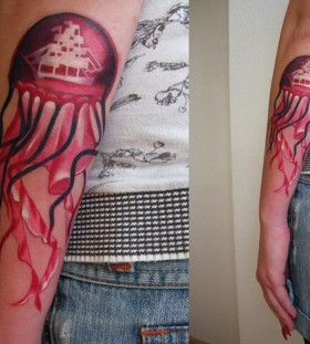 Custom jellyfish arm tattoo