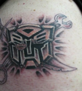 Custom transformers logo tattoo