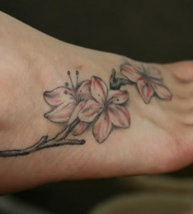 Cute apple blossom foot tattoo