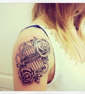 Cute birdcage arm tattoo