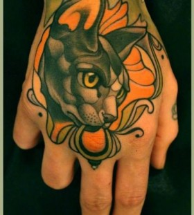 Cute cat hand tattoo by Lars Uwe Jensen