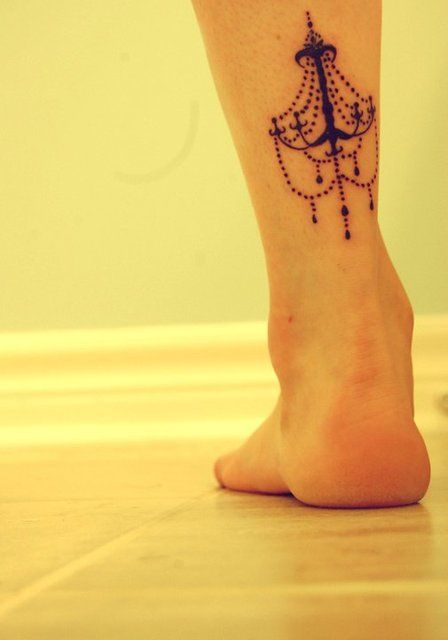 Cute chandelier leg tattoo