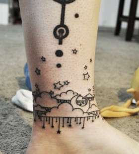 Cute clouds ankle tattoo