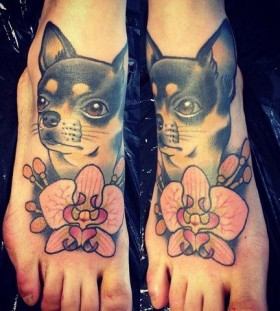 Cute dog foot tattoo by Alex Dorfler