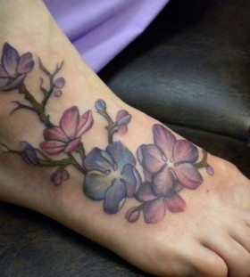 Cute flowers foot tattoo by Amanda Leadman