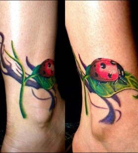 Cute ladybug and leaf tattoo