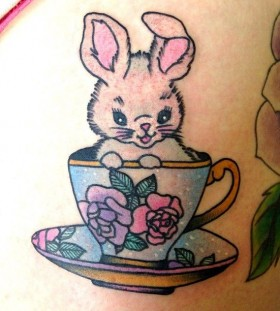 Cute rabbit in cup tattoo by lauren winzer