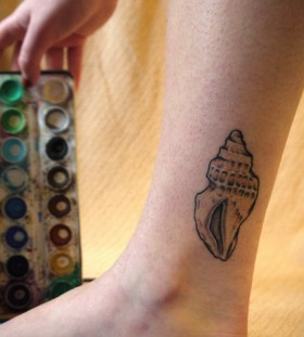 Cute sea shell leg tattoo