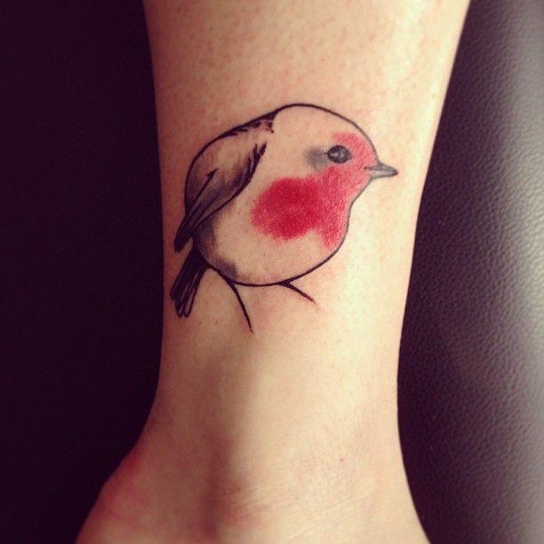 Cute small bird tattoo