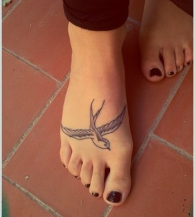 Cute swallow foot tattoo