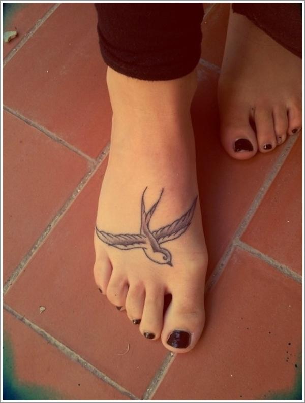 Cute swallow foot tattoo