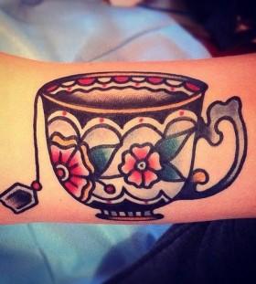 Cute teacup tattoo by Nick Oaks
