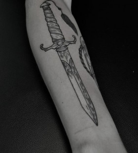 Dagger arm tattoo by Thomas Cardiff