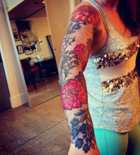 Dahlia flowers arm tattoo
