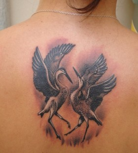 Dancing cranes back tattoo