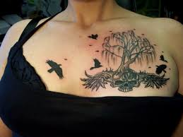 Dead tree and birds chest tattoo