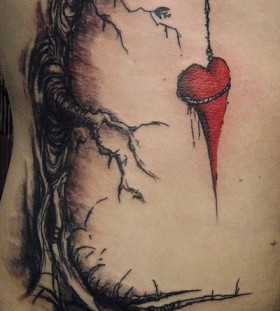 Dead tree and hanging heart tattoo by David Allen